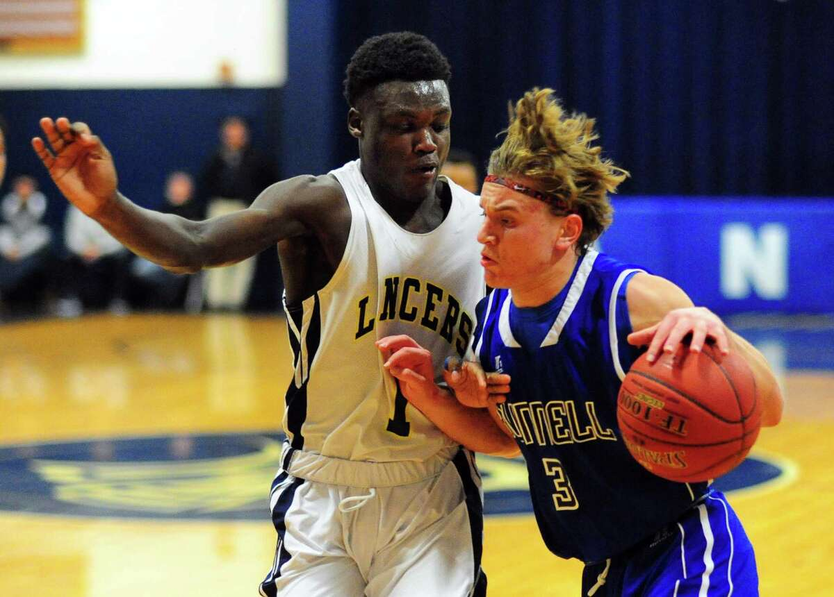 Bunnell's Brett Bogdwicz, right, works to drive past Notre Dame of Fairfield's Damion Medwinter during boys basketball action in Fairfield, Conn., on Thursday Dec. 22, 2016.