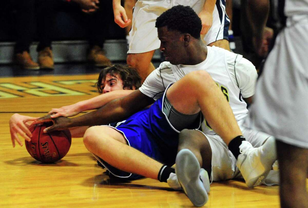 Notre Dame of Fairfield's Micah Brantley reaches to steal away the ball from Bunnell's Anthony Gordon during boys basketball action in Fairfield, Conn., on Thursday Dec. 22, 2016.