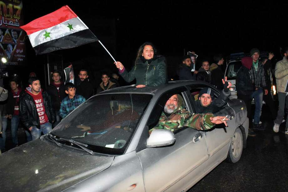Syrians celebrate on December 22, 2016 in the northern Syrian city of Aleppo, after the army said it has retaken full control of the country's second city The army said it has retaken full control of Syria's devastated second city Aleppo, scoring its biggest victory against opposition forces since the civil war erupted in 2011. / AFP PHOTO / George OURFALIANGEORGE OURFALIAN/AFP/Getty Images Photo: GEORGE OURFALIAN / AFP or licensors