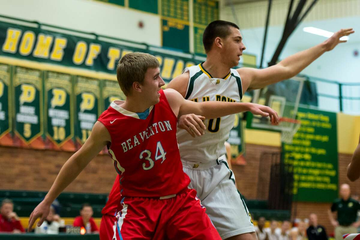 Dow's Kevin Murray, right, defends Beaverton's Cameron Schneider on Thursday at H. H. Dow High School.