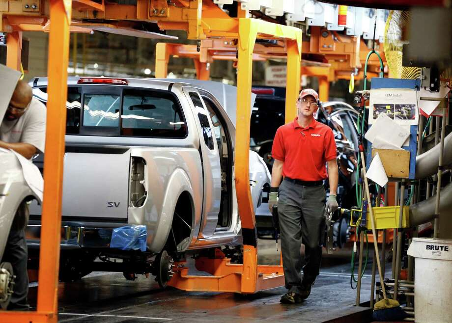 Trucks move along the assembly line at the Nissan Canton plant in Mississippi. Photo: Rogelio V. Solis, STF / Copyright 2016 The Associated Press. All rights reserved. This material may not be published, broadcast, rewritten or redistribu