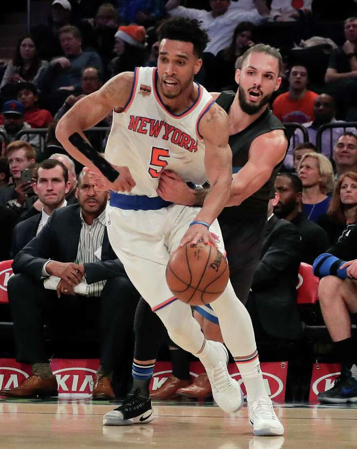 Orlando Magic guard Evan Fournier (10) tries to strip the ball from New York Knicks guard Courtney Lee (5) during the third quarter of an NBA basketball game, Thursday, Dec. 22, 2016, in New York. The Knicks won 106-95. (AP Photo/Julie Jacobson) ORG XMIT: NYJJ117 Photo: Julie Jacobson / Copyright 2016 The Associated Press. All rights reserved.