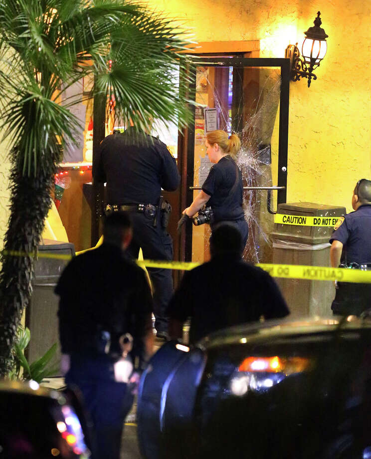 San Antonio police invesigate a shooting incident Thursday December 22, 2016 on the 4,000 block of Northwest Loop 410 at the Fiesta Inn and Suites. Sergeant Ethan Humble said a man with a baseball bat hit a security guard in the motel's lobby and the guard used pepper spray in defense. After the pepper spray had little to no effect on the guard's assailant, the secuity guard fired one shot at the 32-year-old man killing him, Humble said. The security guard was wounded in the head and was transported by EMS to an area hospital Humble said. The incident took place shortly after 8:00 p.m. . Photo: John Davenport, San Antonio Express-News / ©San Antonio Express-News/John Davenport
