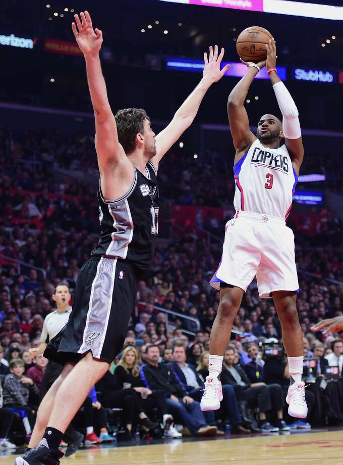 LOS ANGELES, CA - DECEMBER 22:  Chris Paul #3 of the Los Angeles Clippers shoots a jumper over Pau Gasol #16 of the San Antonio Spurs during the second quarter of the game at Staples Center on December 22, 2016 in Los Angeles, California.  (Photo by Harry How/Getty Images) Photo: Harry How/Getty Images