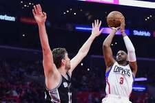 LOS ANGELES, CA - DECEMBER 22:  Chris Paul #3 of the Los Angeles Clippers shoots a jumper over Pau Gasol #16 of the San Antonio Spurs during the second quarter of the game at Staples Center on December 22, 2016 in Los Angeles, California.  (Photo by Harry How/Getty Images)