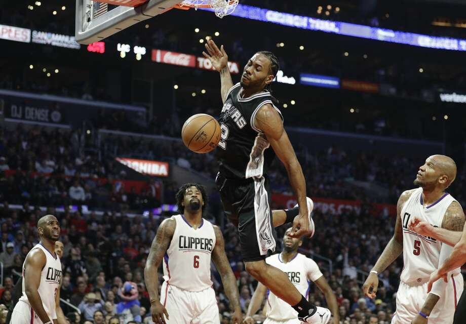 San Antonio Spurs' Kawhi Leonard descends after making a basket during the first half of an NBA basketball game against the Los Angeles Clippers on Thursday, Dec. 22, 2016, in Los Angeles. (AP Photo/Jae C. Hong) Photo: Jae C. Hong/Associated Press
