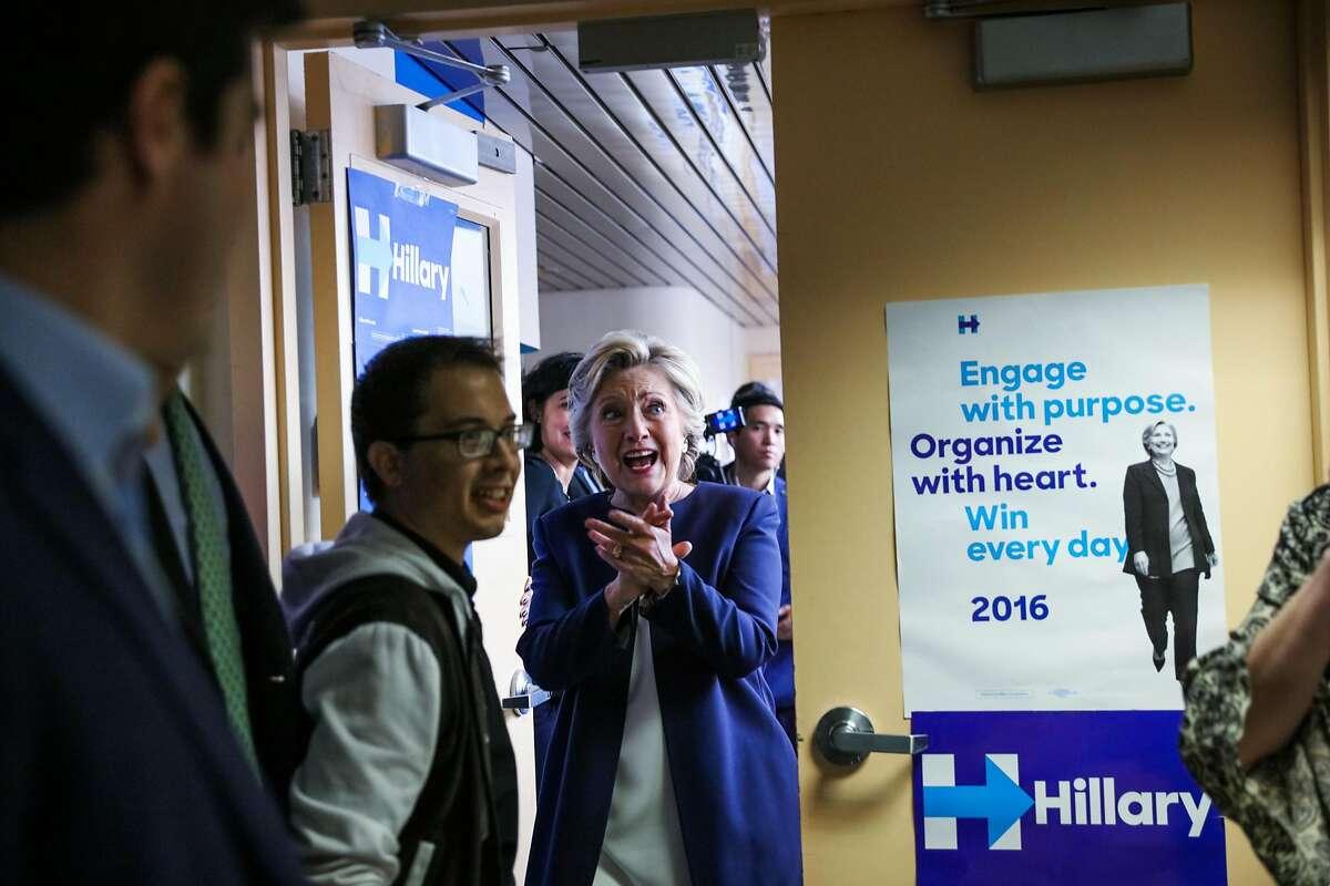U.S. Democratic Presidential nominee Hillary Clinton (center) walks into the DNC headquarters on Van Ness Avenue in San Francisco, California, on Thursday, Oct. 13, 2016.