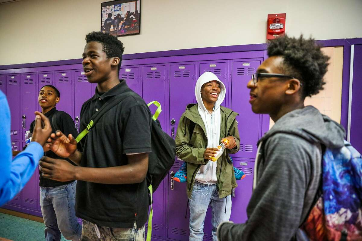 (l-r) Larry Gardner, Demond Turnage, Dwon Elder, Dana Gaines and Terence Riley chat in the hallway in between classes at Castlemont High School, in Oakland, California, on Monday, Oct. 3, 2016.