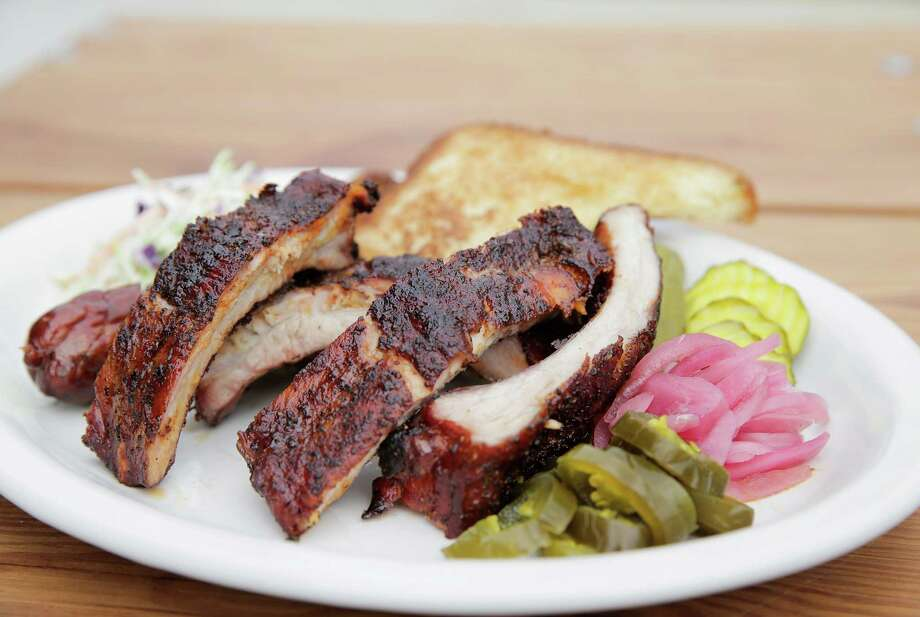 Beaver's Westheimer opened Jan. 2, 2017. Shown: Beaver's pork ribs and sausage. Photo: Elizabeth Conley, Houston Chronicle / © 2016 Houston Chronicle