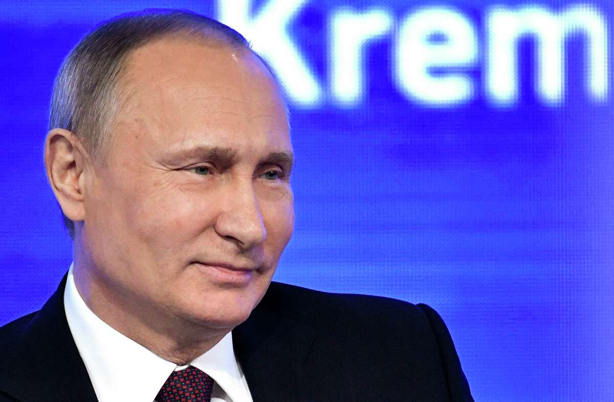 Russian President Vladimir Putin speaks during his annual news conference in Moscow, Russia, Friday, Dec. 23, 2016. (Alexei Nikolsky, Sputnik, Kremlin Pool Photo via AP)