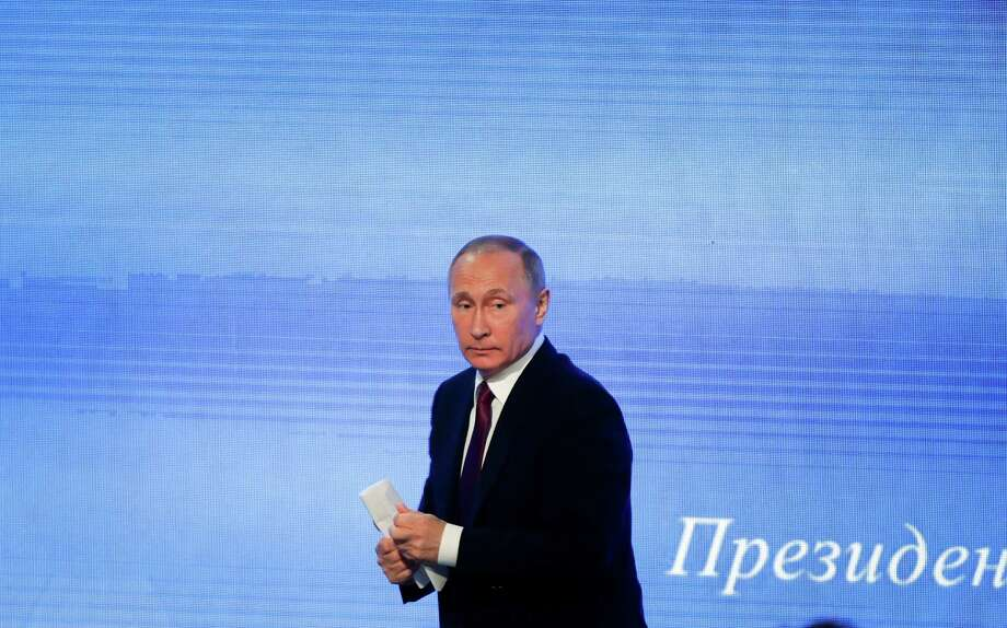 Russian President Vladimir Putin leaves his annual news conference in Moscow, Russia, Friday, Dec. 23, 2016. Putin says he would be willing to visit the United States if President-elect Donald Trump sends him an invitation. Photo: Pavel Golovkin, AP / Copyright 2016 The Associated Press. All rights reserved.