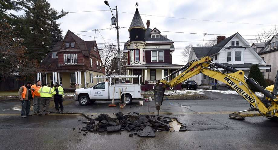 Second Avenue is closed between 123rd and 124th streets to allow Troy's water department workers to repair a ruptured water main Friday. The damaged portion of the 8-inch pipe dates to the 1900s, city officials said. (Skip Dickstein / Times Union)