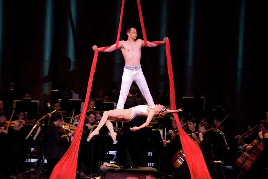Aerial duo Alexander Streltsov & Christine Van Loo perform with a symphony. The Houston Symphony will kick off the new year with a gravity-defying, stunningly visual and musical spectacle that will bring that magic of cirque to Jones Hall at 8 p.m. Jan. 6-7 and 2:30 p.m. Jan. 8.