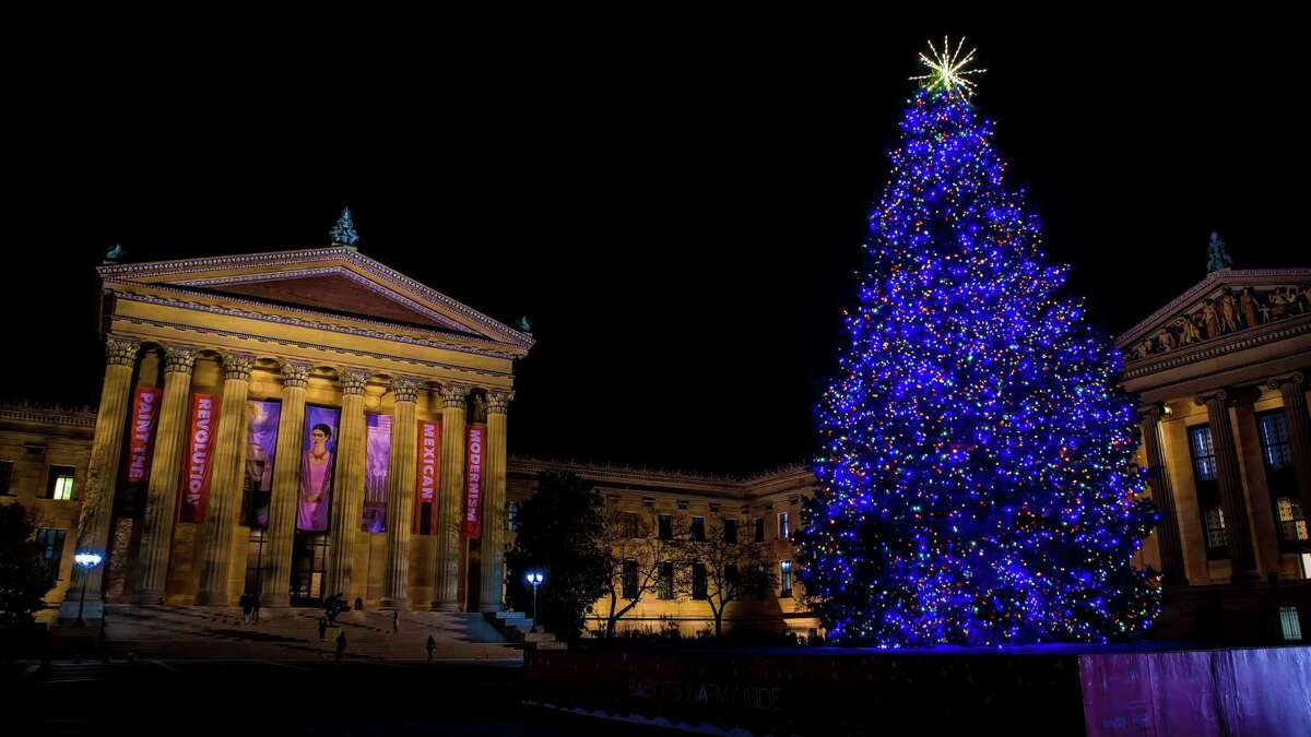 Adorned with glittering holiday lights, a gigantic holiday tree dominates the top of the Philadelphia Museum of Art's world-famous steps, bringing a festive accent to the city vista.