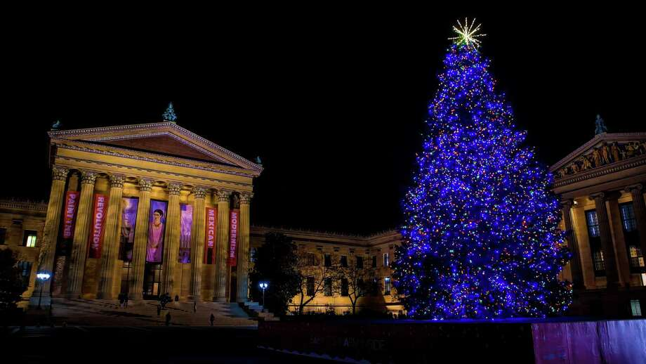 Adorned with glittering holiday lights, a gigantic holiday tree dominates the top of the Philadelphia Museum of Art's world-famous steps, bringing a festive accent to the city vista. Photo: Courtesy J. Fusco / VISIT PHILADELPHIA / EDITORIAL AND ADVERTISING USE APPROVED; ©VISIT PHILADELPHIA®