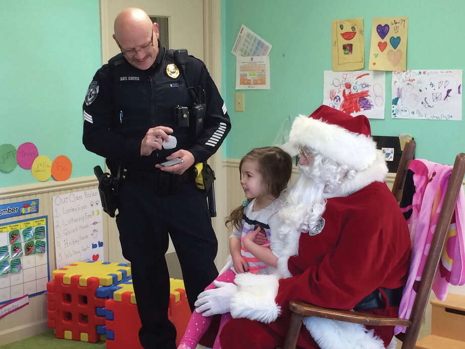 Children at the YMCA Early Childhood Development Center get a visit from Santa Claus. Each year Glen Carbon Police Sgt. Paul Cates and his wife Denise organize the visits to Glen Carbon childcare facilities. Photo: John Sommerhof • Intelligencer