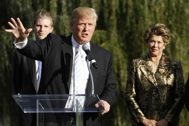FILE - Donald Trump talks as he joins Patricia Kluge, right, and his son, Eric, left, during a news conference in Charlottesville, Va., Tuesday, Oct. 4, 2011. Trump is marking the opening of his Virginia wine enterprise, which he purchased from former socialite Patricia Kluge and her husband after the bank foreclosed on their business. (AP Photo/Steve Helber)