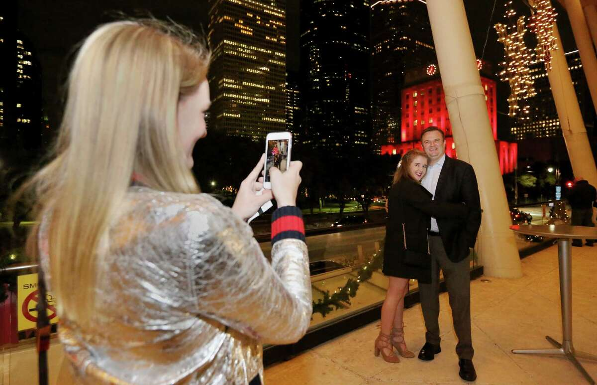 """Sydney Holt takes a photo of Houston Rockets General Manager Daryl Morey and his daughter Karen Morey at Hobby Center balcony before watching """"Into the Woods"""" musical Sunday, Dec. 18, 2016, in Houston. ( Yi-Chin Lee / Houston Chronicle )"""