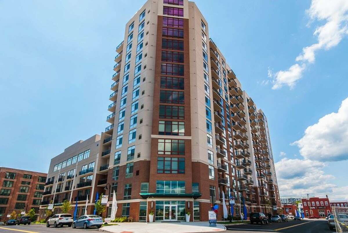 111 Harbor Point is one of five apartment buildings in the Harbor Point development that have together sold for approximately $395 million to a Manhattan firm.