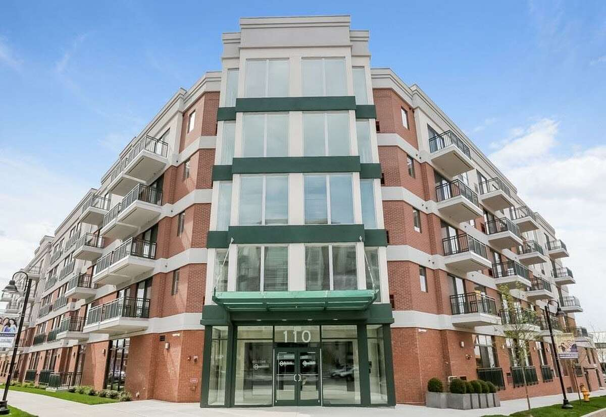 The Key at Yale & Towne is one of five apartment buildings in the Harbor Point development that have together sold for approximately $395 million to a Manhattan firm.