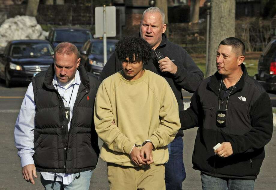 FILE — Elmer Gomez Ruano, center, is lead into Stamford Police Headquarters on Dec. 22, 2016 by Investigator Edward Davis, Lead Investigator Sgt. Chris Broems and Investigator Rafael Barquero, following an appearance in a Manhattan courtroom to waive extradition in exchange for the dismissal of a child endangerment charge in New York, his Stamford attorney Darnell Crosland said. Crosland said his client is cooperating with Stamford police. Photo: Matthew Brown / Hearst Connecticut Media / Stamford Advocate