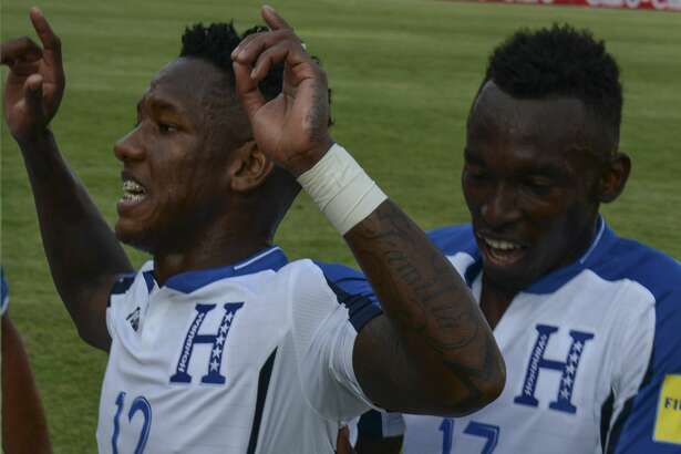 Honduras' Romell Quioto (L) celebrates with teammates after scoring against Trinidad & Tobago during their 2018 FIFA World Cup qualifier football match in San Pedro Sula, Honduras on November 15, 2016. / AFP / ORLANDO SIERRA        (Photo credit should read ORLANDO SIERRA/AFP/Getty Images)