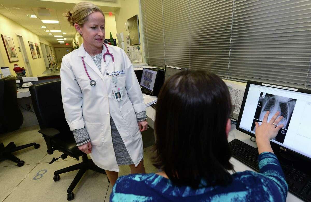 Dr. Alicia Briggs, Interim Chairman of Pediatrics at Norwalk Hospital and Interim Network Director of Pediatric Hospitalist Medicine confers with Pediatric Hospitalist Amanda Begley at Norwalk Hospital on Thursday.