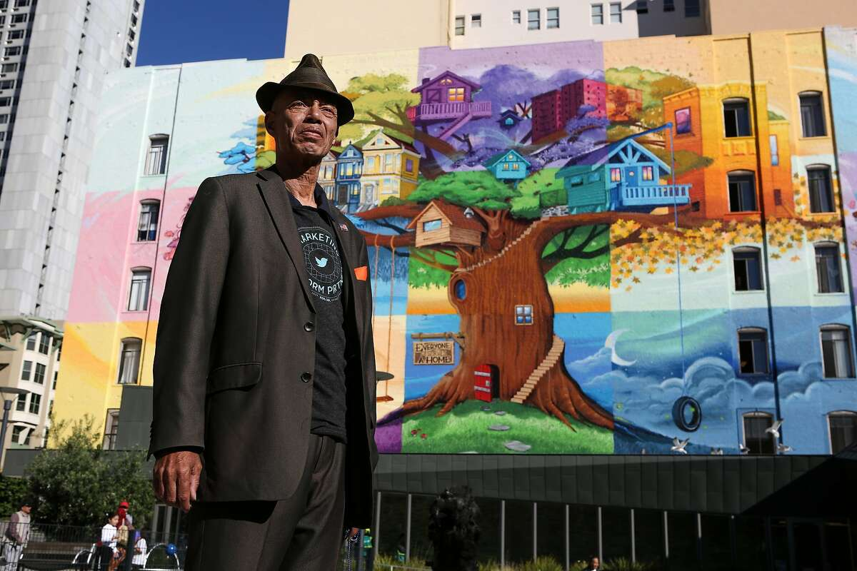 """Del Seymour, founder of a job readiness program called Code Tenderloin, stands in front of a mural in the Tenderloin entitled """"Everyone Deserves a Home"""" on Wednesday, November 16, 2016 in San Francisco, Calif."""