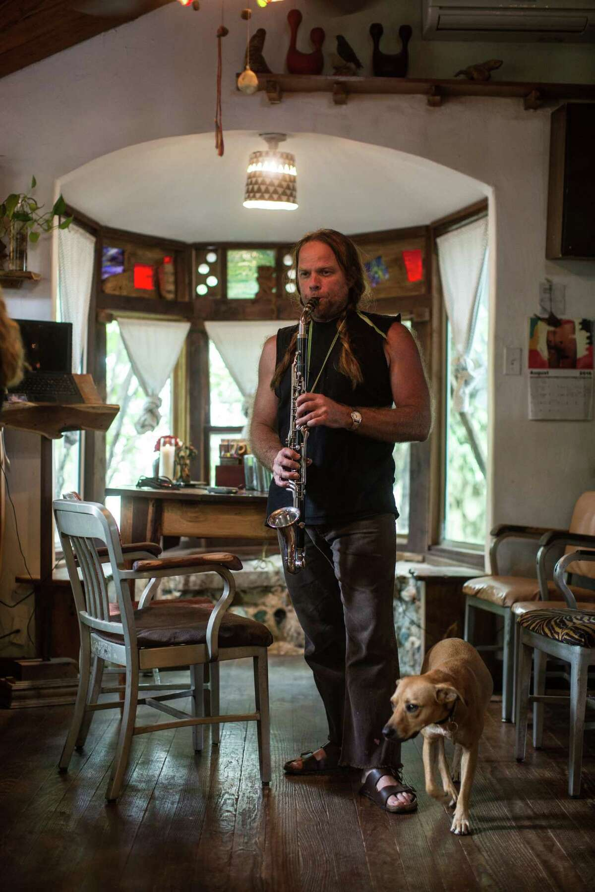 Thor Harris, multi-instrumentalist and artist, plays an alto clarinet in the living room of his home in Austin, Texas. Harris' new band,