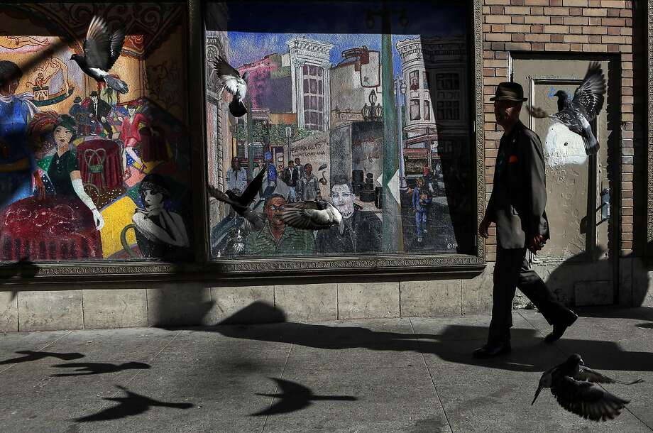 Del Seymour, founder of a job readiness program called Code Tenderloin, walks ahead of the group on the Tenderloin Walking Tour on Wednesday, November 16, 2016 in San Francisco, Calif. Photo: Amy Osborne, Special To The Chronicle
