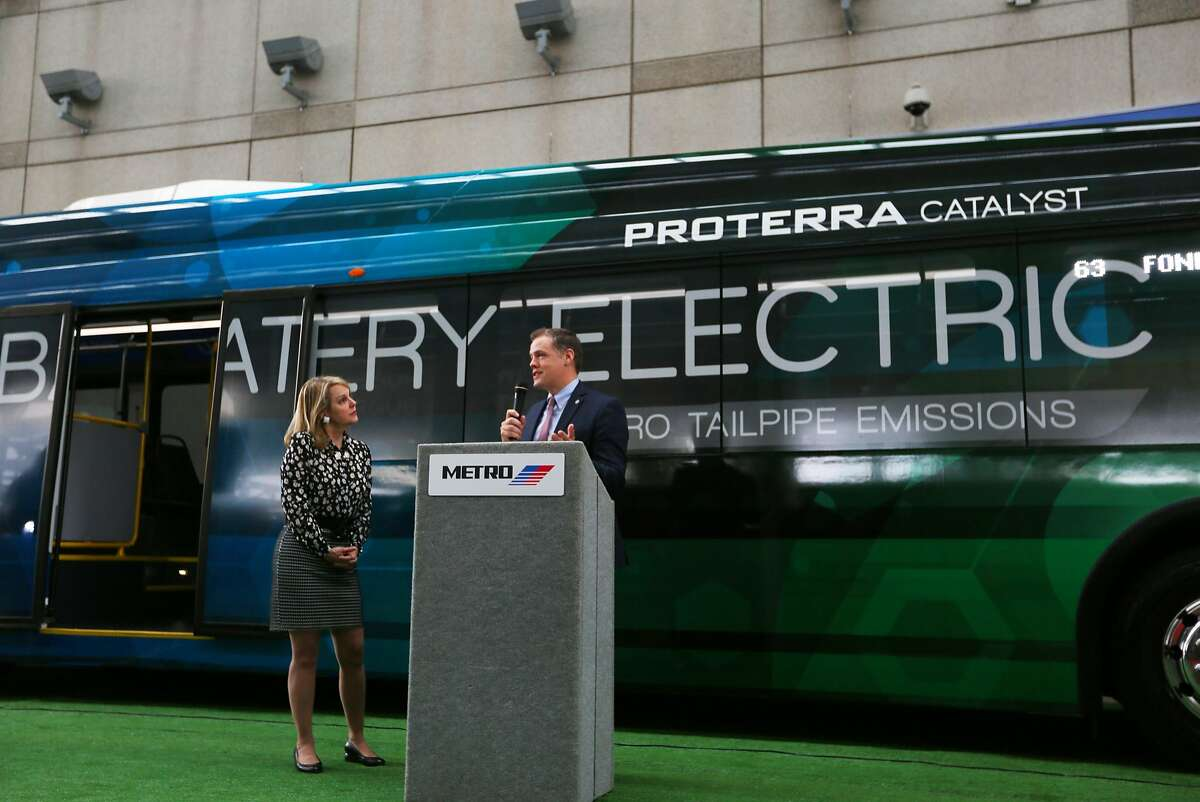 Metro board chair Carrin Patman (left) listens as Matt Horton with Proterra talks about the new battery electric bus that Metro will be using in a pilot program for the next three months, Tuesday, Nov. 29, 2016, in Houston. ( Mark Mulligan / Houston Chronicle )