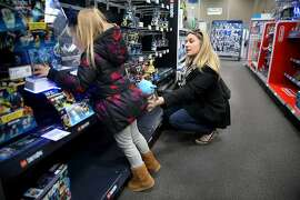 Charlotte Bryan (left), 4 years old, checks out a lego section with her mother Jenna Bryan at Best Buy on Wednesday, December 21, 2016, in San Francisco, Calif.