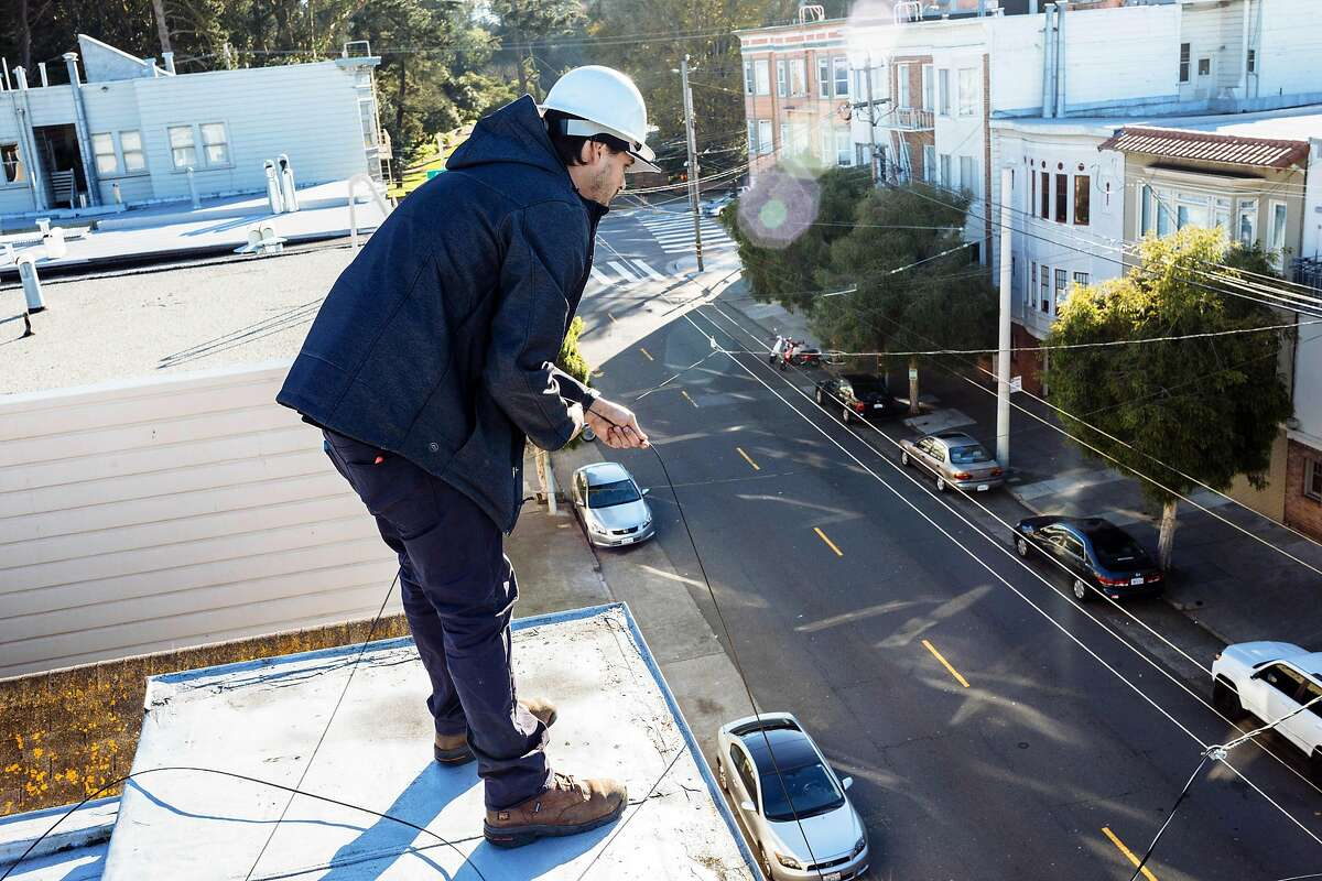 Vito Casas, prepares the fiber wire for the internet installation. Sonic's mission is to bring the fastest and most affordable internet to it's customers.