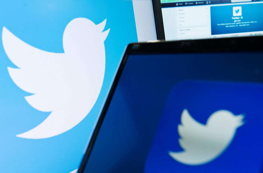 """(FILES) This file photo taken on September 11, 2013 shows the logo of social networking website 'Twitter'  displayed on a computer screen in London. Twitter on August 18, 2016 announced that it has cut off 235,000 more accounts for violating its policies regarding promotion of terrorism at the global one-to-many messaging service. The latest account suspensions raised to 360,000 the total number of accounts sidelined since the middle of 2015 and was helping """"drive meaningful results"""" in curbing the activity, according to the San Francisco-based company.  / AFP PHOTO / LEON NEALLEON NEAL/AFP/Getty Images Photo: LEON NEAL, AFP/Getty Images"""