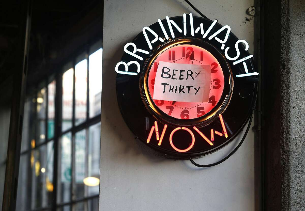 A neon clock hangs on the wall at the Brainwash cafe and laundromat in San Francisco, Calif. on Friday, Dec. 16, 2016. Owner Jeff Zalles has noticed a dramatic drop in business ever since a large residential development currently under construction broke ground next door to the Brainwash and is concerned he may have to shut down.