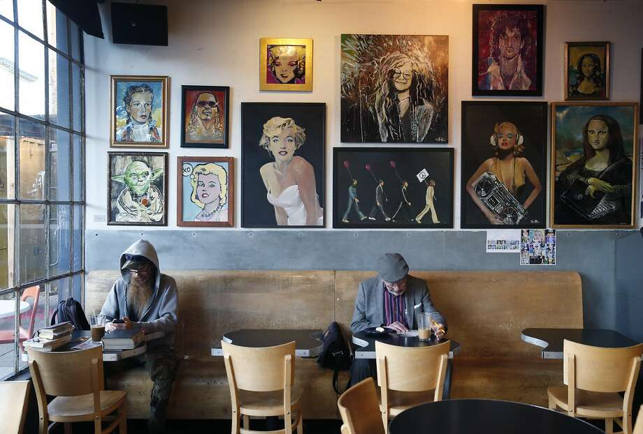 Customers read while sipping coffee at the Brainwash cafe and laundromat in San Francisco, Calif. on Friday, Dec. 16, 2016. Owner Jeff Zalles has noticed a dramatic drop in business ever since a large residential development currently under construction broke ground next door to the Brainwash and is concerned he may have to shut down. Photo: Paul Chinn, The Chronicle
