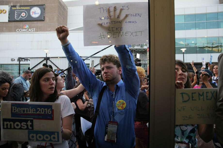 Supporters of Sen. Bernie Sanders campaign protest during the Democratic National Convention in July 26, infuriated by reports that 60,000 emails were stolen by Russian hackers from the email account of John Podesta, campaign chairman for Hillary Clinton. A reader says U.S. intelligence officials must investigate the hacking. Photo: RUTH FREMSON /NYT / NYTNS