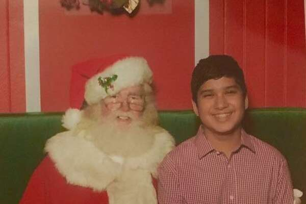 To please his mom, Jared Ramirez has agreed to pose with Santa every year, though he is now 14. His time with Santa this year.