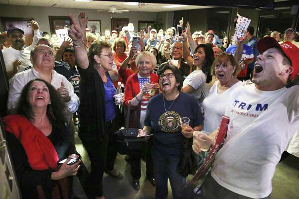 Republicans at an election night watch party in San Antonio celebrate as Florida is declared for Donald Trump. Despite that upset victory, the GOP in Bexar County suffered some disappointing losses.