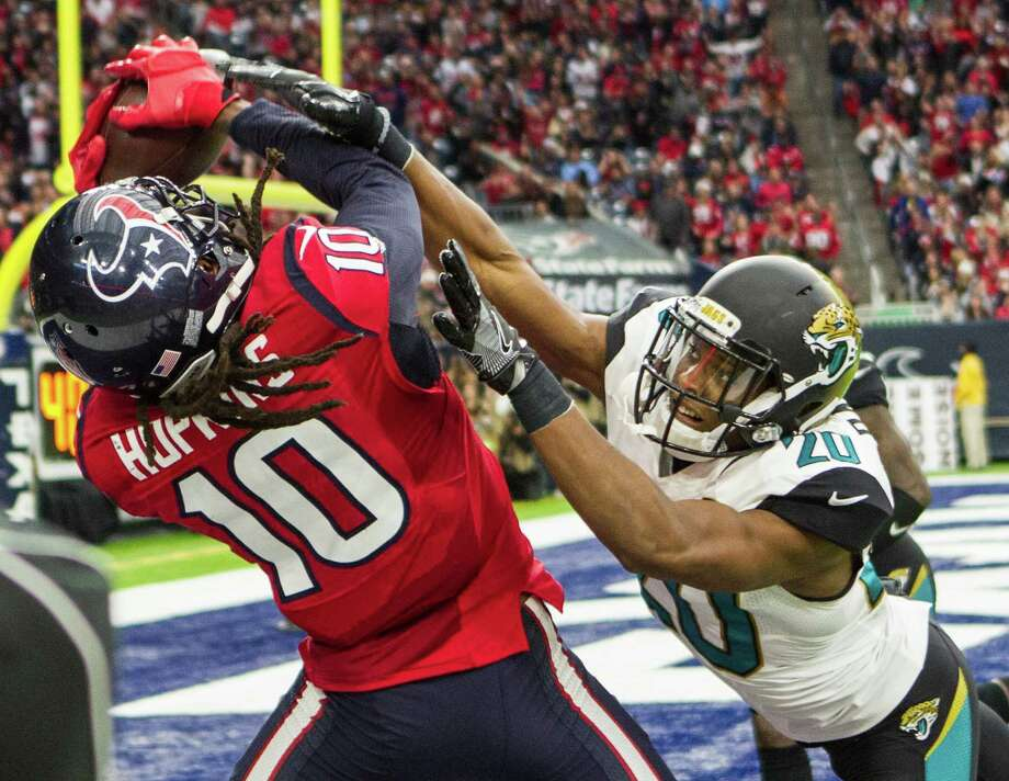 Houston Texans defensive back Don Jones (20) breaks up a pass intended for Houston Texans wide receiver DeAndre Hopkins (10) in the end zone during the third quarter of an NFL football game at NRG Stadium on Sunday, Dec. 18, 2016, in Houston. ( Brett Coomer / Houston Chronicle ) Photo: Brett Coomer, Staff / © 2016 Houston Chronicle