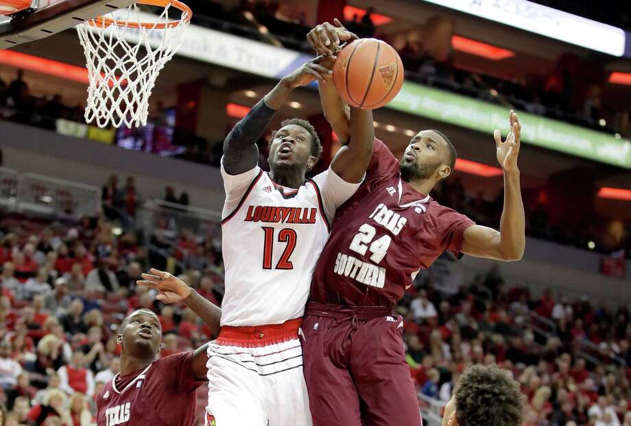 LOUISVILLE, KY - DECEMBER 10:  Magok Mathiang #12 of the Louisville Cardinals and Marvin Jones #24 of the Texas Southern Tigers battle for a rebound during the game at KFC YUM! Center on December 10, 2016 in Louisville, Kentucky.  (Photo by Andy Lyons/Getty Images) Photo: Andy Lyons, Staff / 2016 Getty Images