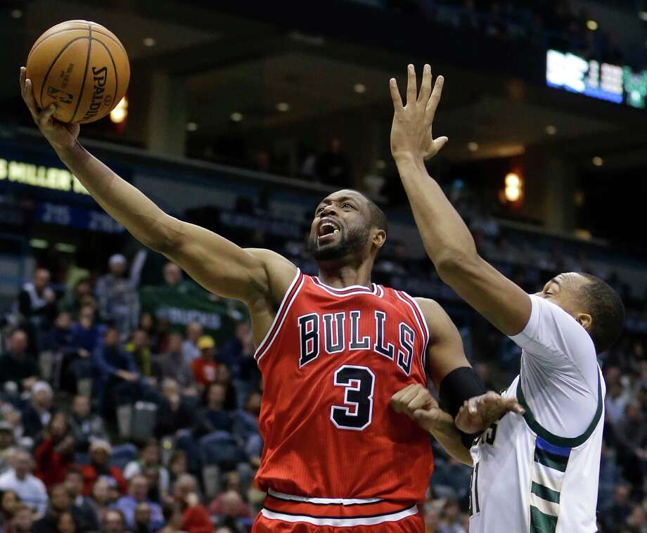 Chicago Bulls' Dwyane Wade (3) goes up for a shot against Milwaukee Bucks' John Henson during an NBA basketball game Thursday, Dec. 15, 2016, in Milwaukee. (AP Photo/Aaron Gash) Photo: Aaron Gash, FRE / FR171181 AP