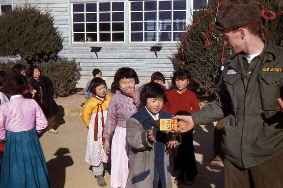 South Korean schoolchildren received presents from an unidentified U.S. soldier on Christmas Day 1956.