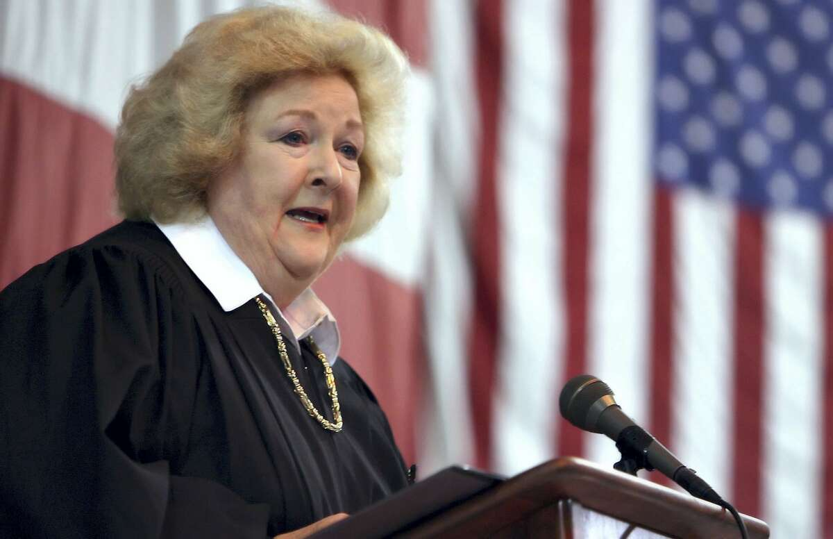 In this July 4, 2008 photo, U.S. District Judge Janis Graham Jack administer the U.S. oath of citizenship to more than 100 area residents representing 25 countries aboard the USS Lexington.