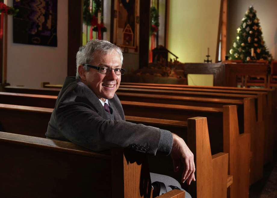 Rev. Johan Bosman sits in the sanctuary at Christ Community Reformed Church on Wednesday, Dec. 21, 2016 in Clifton Park, N.Y. (Lori Van Buren / Times Union) Photo: Lori Van Buren / 20039204A