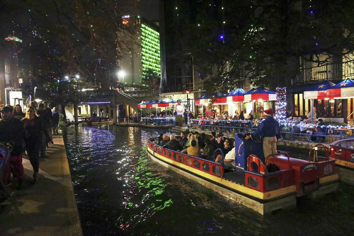 The River Walk is lit with Christmas lights on Dec. 22 and buzzing with tourists. Travel + Leisure recently named San Antonio No. 1 on its online list of Favorite Cities for Christmas Lights.