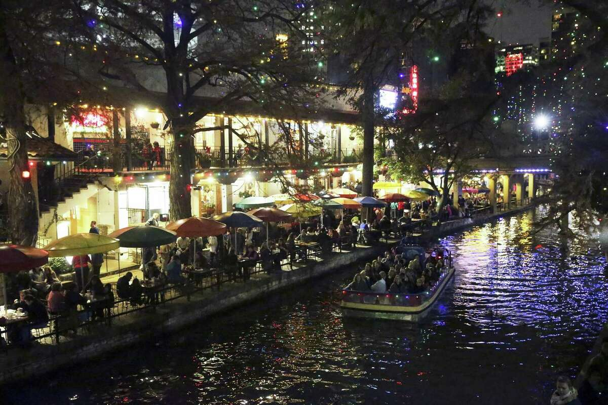 The River Walk is lit with Christmas lights on Dec. 22. Mayor Ivy Taylor has said the bidding process for who runs the barges plying the waterway was tainted