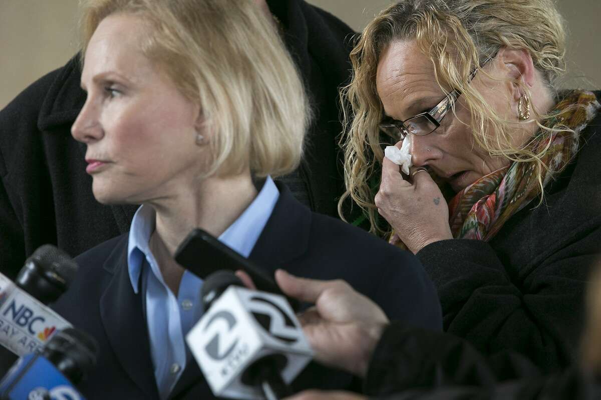 From right: Kimberly Gregory wipes her tears as her attorney Mary Alexander answers questions during a news conference after they filed a lawsuit on Friday, Dec. 23, 2016 in Oakland, Calif. The first lawsuit in the Oakland Ghost Ship fire was filed on behalf of David Gregory and Kimberly Gregory, whose daughter Michela Gregory, a 20-year-old San Francisco State University student, died in the Dec. 2 Oakland warehouse fire.