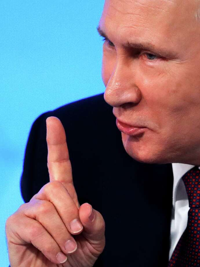 Russian President Vladimir Putin gestures while speaking during his annual news conference in Moscow, Russia, Friday, Dec. 23, 2016. (AP Photo/Pavel Golovkin) Photo: Pavel Golovkin, STF / Copyright 2016 The Associated Press. All rights reserved.