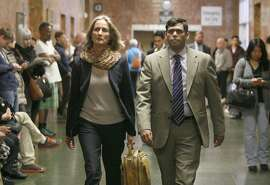 Enrique Pearce, right, and his lawyer Eileen Burke head into a courtroom inside the Hall of Justice, Wednesday, May 13, 2015, in San Francisco, Calif. Pearce a political consultant for S.F. Mayor Ed Lee, was arraigned on child porn possession charges. He pleaded not guilty. Pearce was taken into custody after being deemed a public safety risk by the prosecutor. Bail was set to $400,000.